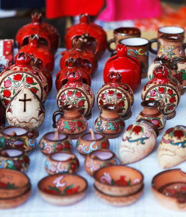 Armenian ancient style pottery clay cup in pomegranate shape the market Vernisazh
